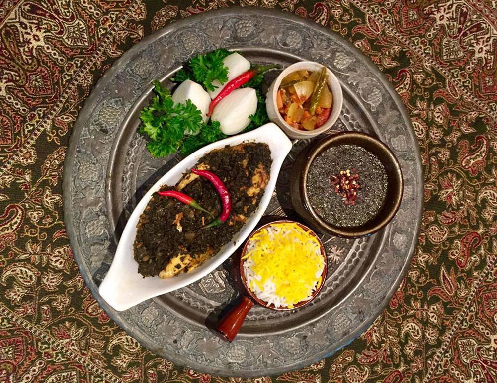 9) Ghalieh Mahi (Spicy Fish with fresh herbs)